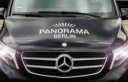 black Mercedes Benz V-Class front view with Panorama Berlin branding