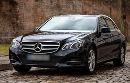 black Mercedes Benz E-Class 2015 as chauffeured economy limousine